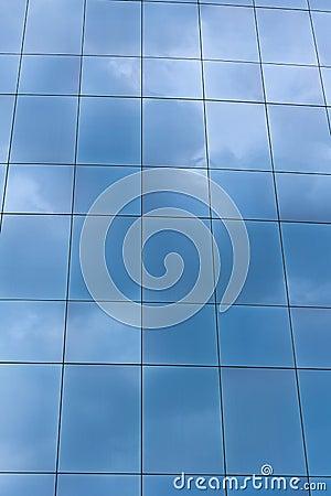 Building windows reflecting sky