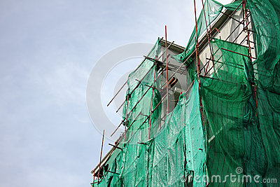 Building wrapped in tarpaulin