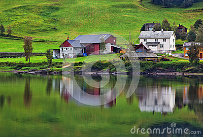Buildings on fjord shore