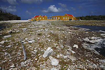 Buildings and rocky shoreline in Bonaire