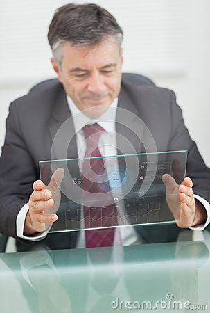 Buisnessman using futuristic touchscreen