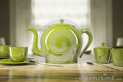Bule e xícaras de chá verdes