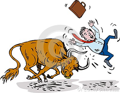 Bull attacking businessman