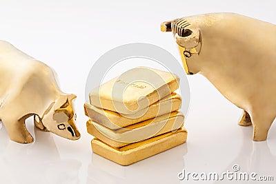 Bull and bear markets symbols with gold bars