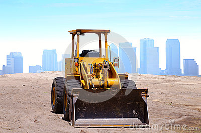 Bulldozer construction site buildings background