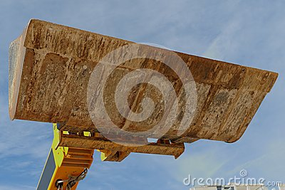 Bulldozer excavation scoop on sky background