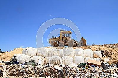 Bulldozer in landfill