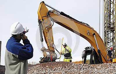 Bulldozer and workers in action