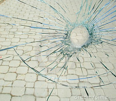 Bullet hole in the broken glass