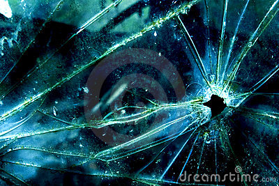 Bullet hole in broken glass