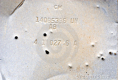 Bullet Holes in an Old Piece of Metal