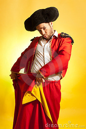 Bullfighter courage red yellow humor spanish color