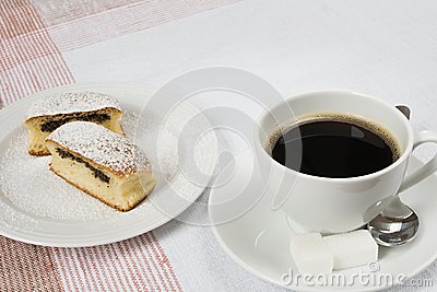 Bun filled with poppy seeds served with coffee