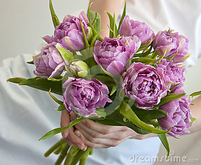 Bunch of flowers in woman s hands
