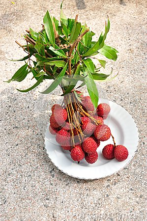 Bunch of fresh lychees on plate