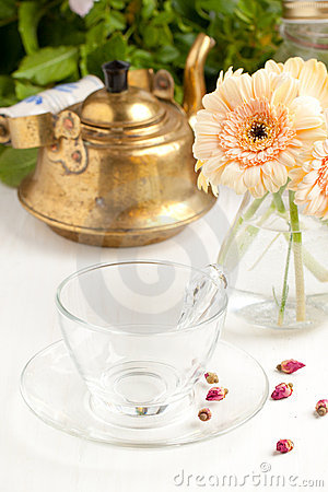 Bunch of gerbera flower with empty glass cup
