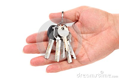Bunch of keys are on a hand.