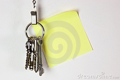 Bunch of keys with sticky note