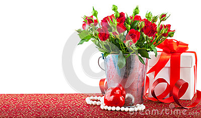 Bunch red roses with gift and heart