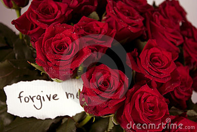 A bunch of roses in vase with note - forgive me