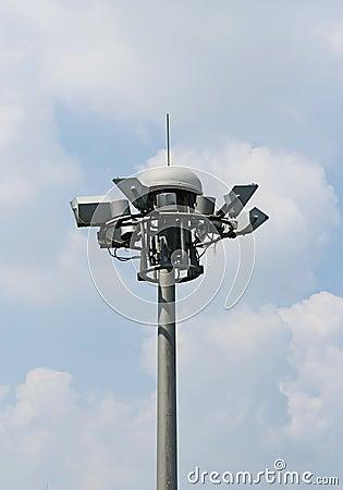 Bunch spot-light pole tower in blue sky