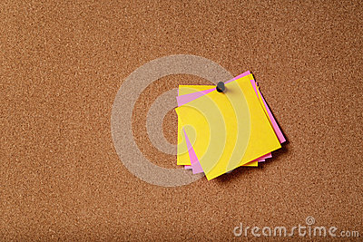 Bunch of sticky notes on cork board