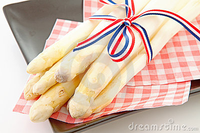 Bundle of fresh Dutch asparagus on napkin