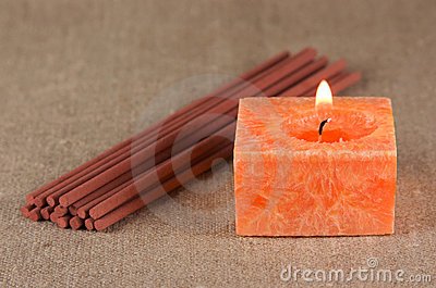 A bundle of incense sticks and a candle