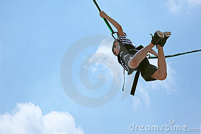 Bungee Jumping Boy Against Sky with Clipping Path