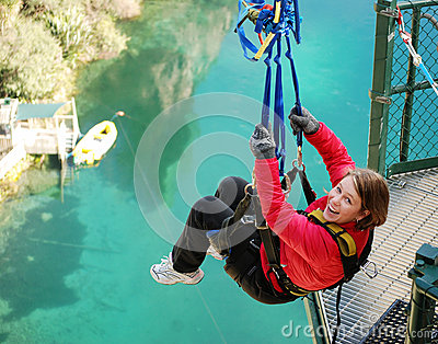 Bungy Jumping off Bridge in Extreme Swing on Lake