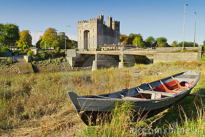 Bunratty castle with boat at the river