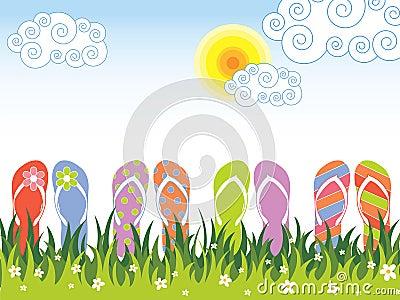 Bunte Flipflops des Sommers im Gras