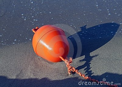 Buoy on a beach during low tide