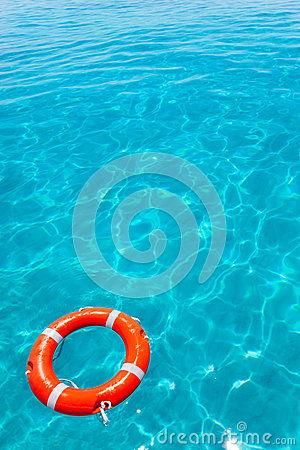 Buoy orange floating in perfect tropical beach