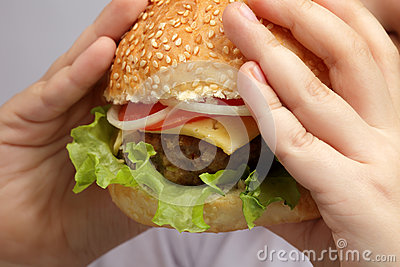 Burger in children hand
