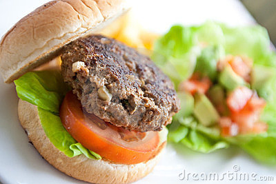 Burger with fresh tomato and lettuce