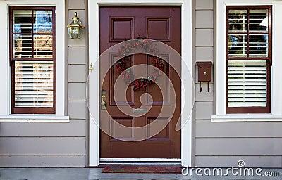 Burgundy door and 2 windows