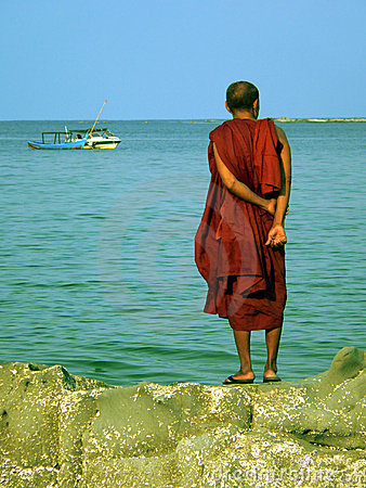 Free Burma. Monk Standing On Rock Stock Image - 2331511
