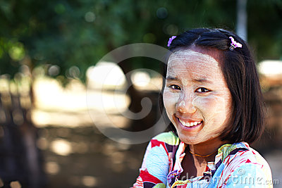 Burmese girl smiling with chalk painted face Editorial Stock Photo