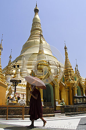 Burmese monk and Shwedagon pagoda Editorial Stock Photo