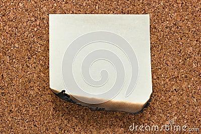Burn sticky note on cork