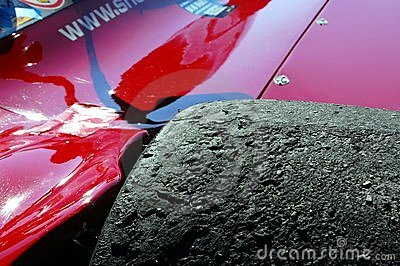Burned Racing Tire with rocks Editorial Stock Image