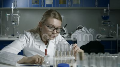 Exhausted scientists sleeping on workplace in lab stock footage
