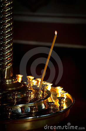 Burning candle in the church