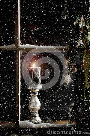 Free Burning Candle In Window Stock Image - 46779801