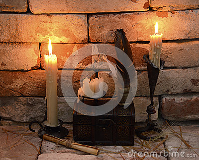 Burning candle with written implements