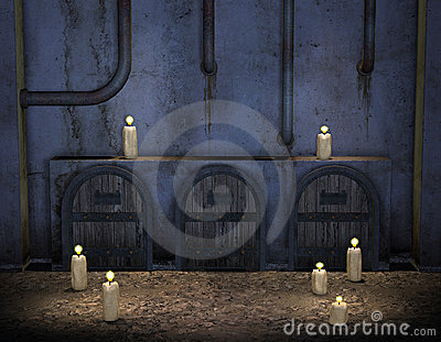 Burning candles in front of an old wall