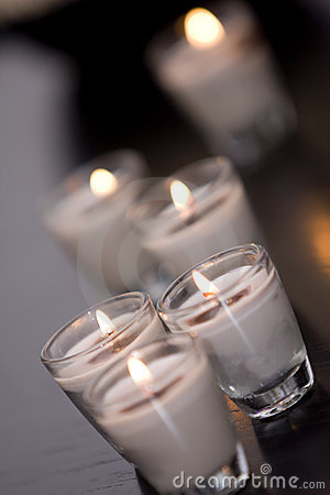 Burning candles in glass holders