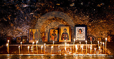 Burning candles and religious icons