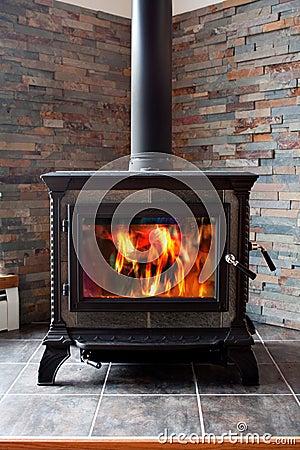 Free Burning Cast Iron Wood Stove Stock Photography - 18517972